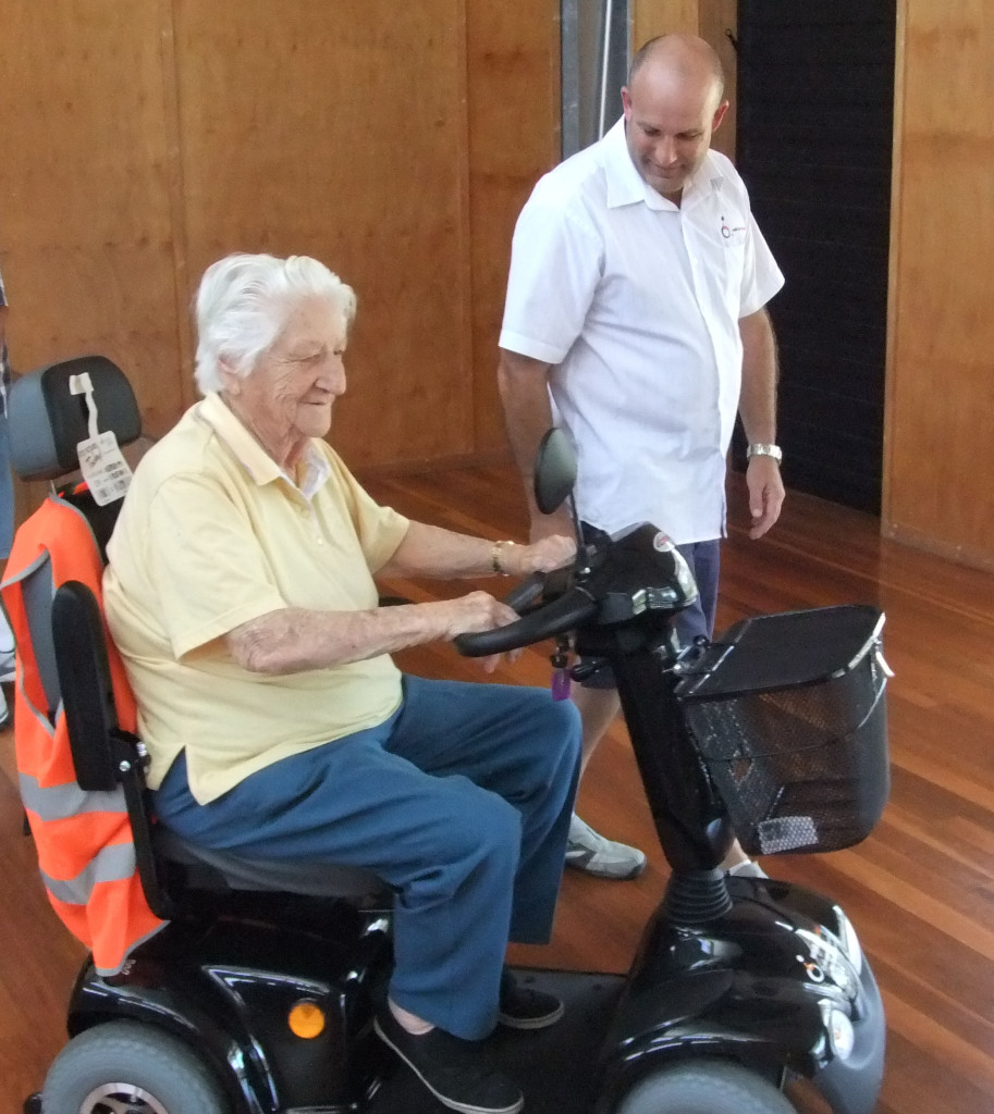 Lyn Garner tries out a mobility scooter with Matt Woosnam from Walk on Wheels.