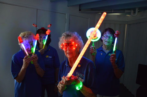 CancerFree volunteers Dell Boyd, Cr Wendy Boglary, June Craven and Del Roeton get set to light up the Redlands with glow products for Christmas by Starlight on December 7.