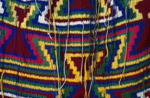 Unknown maker, 'Kundu drum' and pattern bilum (detail) n.d. wool and acrylic fibre. Collected from Port Moresby 1991. Searle Collection. Photography by Carl Warner.